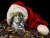 One Hundred Dollars In A Christmas Hat. Dollars On Top On Foreign Metal Coins. Banknote With The Ima poster