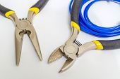 Pliers Tools And Wires For Electrician Closeup On Gray Background poster