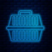 Glowing Neon Line Pet Carry Case Icon Isolated On Brick Wall Background. Carrier For Animals, Dog An poster