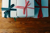Stack Of Gift Wrapped Christmas Presents. A Stack Of Boxes Of White Colors Tied With Different Ribbo poster