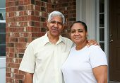 pic of elderly couple  - minority senior couple together outside their home - JPG