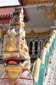 stock photo of bannister  - An ornate dragon bannister adorns the staircase of a chinese temple in the thai city of Hua Hin - JPG