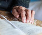 Old Woman Hand On The Open Prayer Book (christian Prayer Book In Ukrainian). Reading The Book. Prayi poster