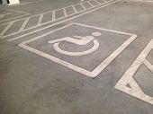 Parking Space For Disabled In Parking Lot. Symbol For Disabled Parking. Wheelchairs Symbol. poster