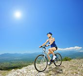 A female biker biking a mountain bike outdoors
