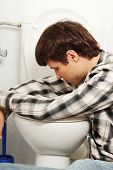 stock photo of vomiting  - Young man  - JPG