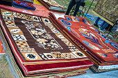 foto of linoleum  - Colorful Carpets and Rugs on Sale at a shop - JPG