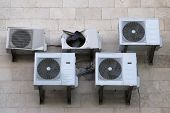 image of air conditioner  - Several air conditioners and one of them is broken - JPG