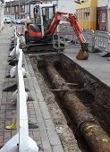 stock photo of safety barrier  - Roadworks for the replacement of new plastic gas pipes being laid with barriers around for health  - JPG