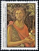 stamp printed in Guinea-Bissau shows St. John the Evangelist by Botticelli