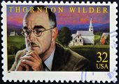 A stamp printed in USA shows Thornton Wilder