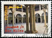 A stamp printed in Tunisia shows Dar Hsine