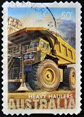 a stamp printed in Australia shows heavy haulers machinery mining