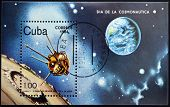 A stamp printed in Cuba shows first satellite to the moon
