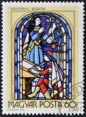 stamp printed in Hungary shows Stained-glass Window 16th century scribe by Ferenc Sebesteny