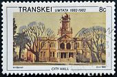 A stamp printed in Transkei shows city hall circa 1982