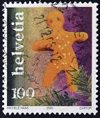 SWITZERLAND - CIRCA 2005: A stamp printed in Switzerland shows gingerbread, circa 2005