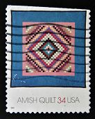 UNITED STATES OF AMERICA - CIRCA 2001: A stamp printed in USA shows a Amish quilt, circa 2001