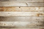 stock photo of wood  - rustic weathered barn wood background with knots and nail holes - JPG