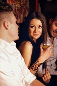 Stunning Woman With Male Friends At The Bar