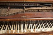 picture of musical scale  - Inside an old piano with strings and screws - JPG