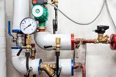 stock photo of valves  - Heating pipes system with valves and counter - JPG