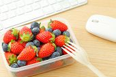 image of lunch box  - Berry mix lunch box at office - JPG