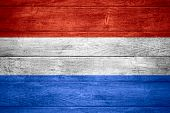stock photo of holland flag  - flag of Holland or Dutch banner on wooden background - JPG