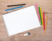 stock photo of pencil eraser  - Blank paper and colorful pencils on the wooden table - JPG