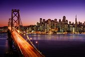 stock photo of colorful building  - San Francisco skyline and Bay Bridge at sunset - JPG