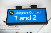 Generic Blue Passport Control Sign At Airport