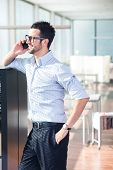 Modern businessman with glases talking  on a cellphone