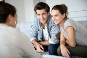 stock photo of family planning  - Couple meeting architect for house construction - JPG