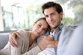 picture of sofa  - Couple at home relaxing in sofa - JPG