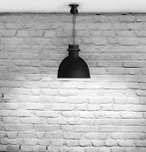 White grunge brick wall and black plafond are lights wall