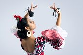 stock photo of castanets  - Portrait of young Flamenco dancer in beautiful dress - JPG