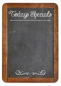 Today Specials - white chalk menu sign on a vintage slate blackboard isolated on white