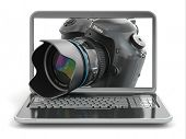 stock photo of private investigator  - Digital photo camera and laptop - JPG