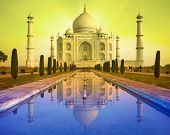 A perspective view of Taj Mahal mausoleum with reflection in water. Agra, India.