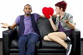 stock photo of bitchy  - black male and caucasian female couple on a couch - JPG