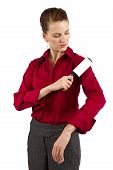 picture of lint  - businesswoman cleaning lint off her shirt getting ready for a presentation - JPG