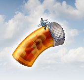 stock photo of harness  - Medical prescription guide concept as a doctor or pharmacist taking control with a harness a flying pill bottle on a cloudy sky as a metaphor for health care drug guidance through leadership and scientific research - JPG