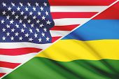 stock photo of mauritius  - Flags of USA and Republic of Mauritius blowing in the wind - JPG