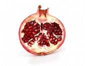 half of pomegranate isolated on white background