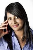 Beautiful Indian Woman talking on the phone