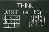 image of tic  - Tic tac toe and words think outside the box - JPG