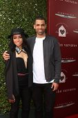 LOS ANGELES - APR 13:  Kat Graham, Cottrell Guidry at the John Varvatos 11th Annual Stuart House Ben