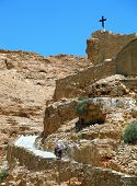On the road, paved with stone, raised on a donkey woman - a pilgrim dressed in white. Wadi Kelt, the