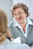 picture of doctors office  - elderly patient  receiving  a prescription or referral - JPG