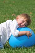 Little Boy Playing With Blue Ball